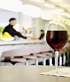 A glass of red wine in a restaurant