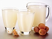Lychee juice in glasses and a glass jug