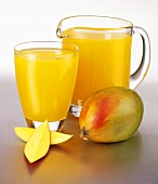 Mango juice in a glass and a glass jug
