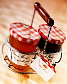 Two jars of French jam in a carrying basket