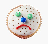 Fairy cake with a sad, spotty face