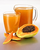 Papaya juice in a glass and in a glass jug