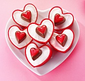 Heart-shaped fairy cakes decorated with heart-shaped pralines