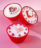 Fairy cakes with heart-shaped decorations