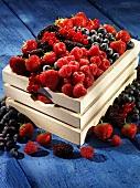 A wooden basket of fresh berries
