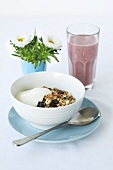 Muesli with yogurt and a blueberry smoothie