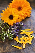 Marigolds, lavender and thyme in a wooden bowl