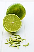 Limes, whole, halved and zest