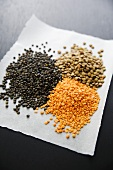Various lentils on a piece of paper