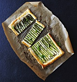 Asparagus tart on greaseproof paper, seen from above