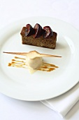 A plum cake with vanilla ice cream