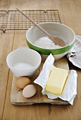 Baking ingredients: flour, sugar, eggs and butter