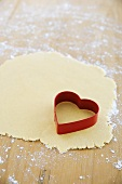 Biscuit dough and a heart-shaped cutter