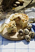 Chicken and ham pie and quails' eggs for a picnic