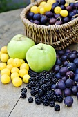 Various types of fruits, some in a basket