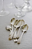 Antique silver spoons and glasses