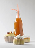 Cupcakes and a bottle of peach ice tea