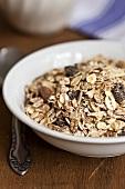 Muesli with raisins in a ceramic bowl