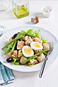 Potato salad with salmon, green beans, eggs and olives