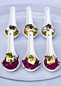 Spoon canapes with red cabbage, Stilton and walnuts