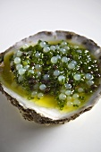 A raw oyster with a caviar vinaigrette