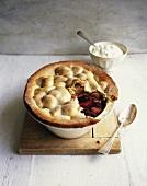 Apple and blackberry pie with cream