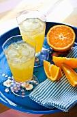 Orange drinks with ice cubes