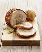 Sliced Rolled Stuffed Pork Roast on Cutting Board