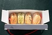 Four macaroons in a take away box