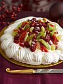 Pavlova with berries and kiwis for Christmas