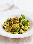 Rice with pork, courgette, almonds and raisins