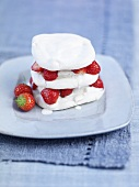 Meringue and cream dessert with strawberries