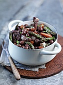 Coq au vin with green asparagus and silver onions