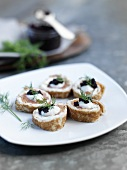 Smoked salmon and cream cheese rolls with caviar and dill