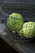 Savoy cabbage in a wire basket