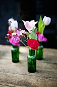 Bunches of flowers in small bottles