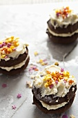 Chocolate whoopie pies with cream and sugar stars