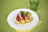 An open ham and cheese sandwich