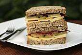 Cheese, gherkin and ham sandwiches