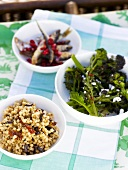 Pasta pearls with olives and dried tomatoes, broccoli, fried sprats with cranberries