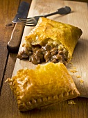 Pastry with beef filling, sliced open