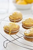 Whoopie Pies with orange glaze on a cooling rack