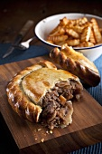 Steak pasty (English pastry), sliced open, with French fries