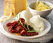 Dried tomatoes and mozzarella on a plate