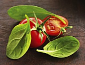 Tomatoes and fresh spinach leaves