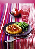A mini puff pastry tartlet with tomatoes
