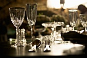 Crystal glasses, crystal bowls and cutlery on a table
