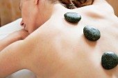Stone theraphy in woman back