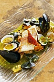 Red mullet in a saffron mussel broth with sepia farfalle