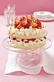 Pavlova with cream and strawberries